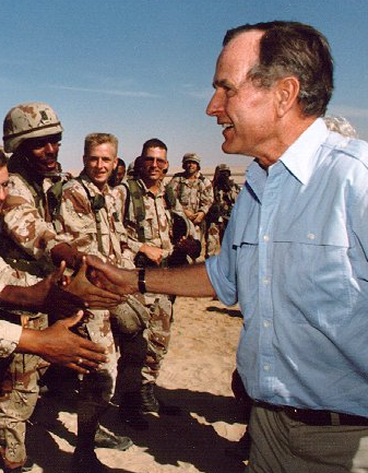 President Bush greets troops in Saudi Arabia, 1990. Photo courtesy Bush Library.