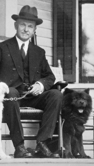President Coolidge with Tiny Tim, a red chow.