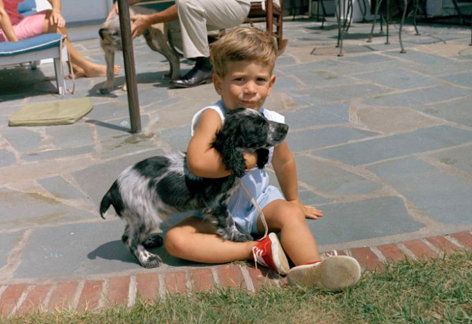 Little John F. Kennedy Jr., age X, plays with Shannon on Aug. 14, 1963.