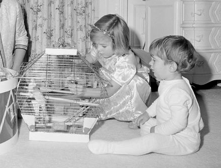 Carolyn and John Jr. with their pet birds.